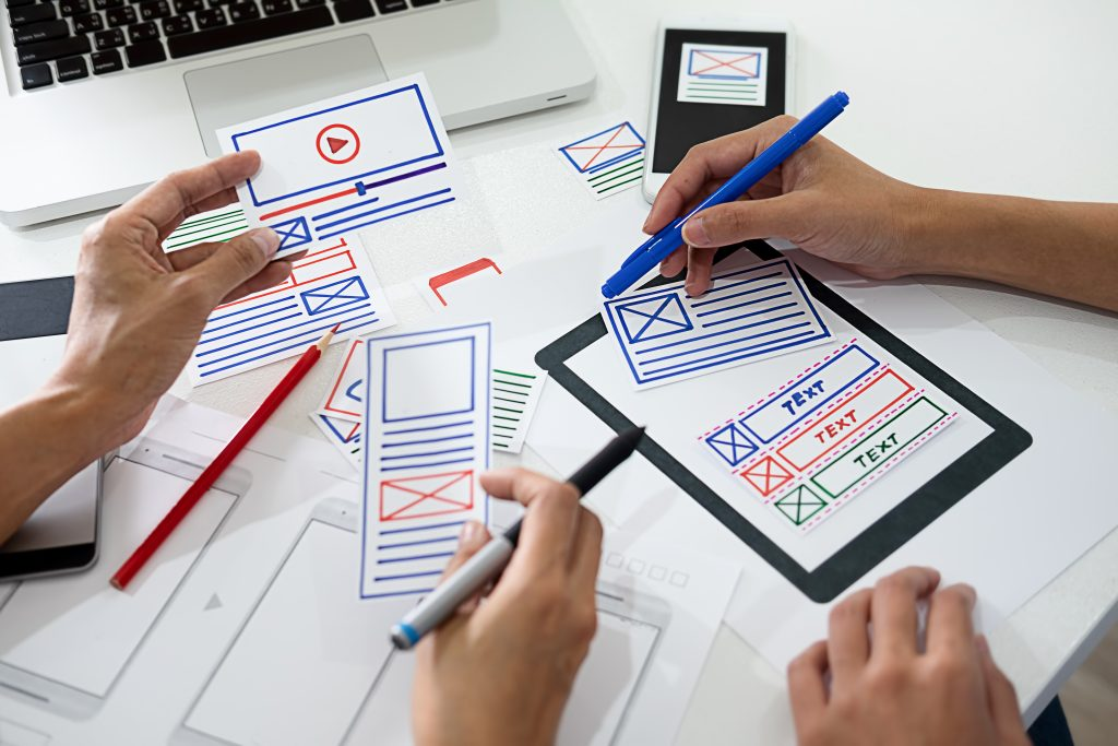 Creative Web Designer planning application and developing templa